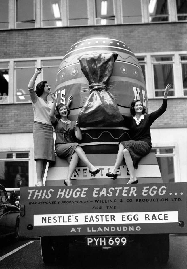 Young ladies with a giant Easter egg before it left for the 'Easter Spectacular' in Llandudno, north Wales.