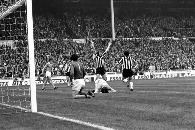 Newcastle United's Mickey Burns (r) and Malcolm MacDonald (second l) rush to congratulate teammate Alan Gowling (arms raised) after he scored the equalizing goal, to the disappointment of Manchester City's Mike Doyle (l), Joe Corrigan (kneeling) and Dave Watson (5)