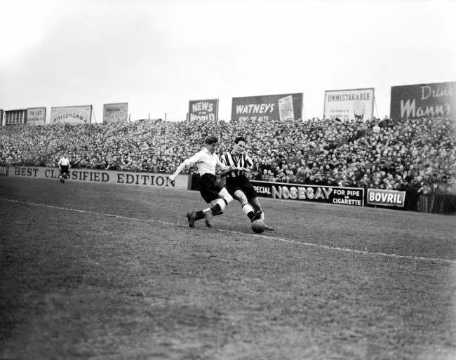 Soccer - Football League Division One - Fulham v Newcastle United (L-R) Fulham's Len Quested tackles Newcastle United's George Robledo Date: 31/03/1951