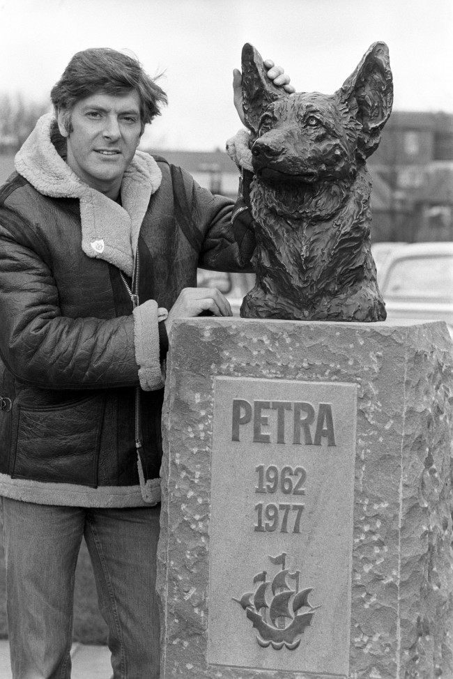 Peter Purves, on his last day as a presenter with the BBC TV programme 'Blue Peter', outside the BBC Television Centre with a bronze statue of Petra, the much loved 'Blue Peter' dog that died in September 1977. The bronze, by sculptor Willaim 'Tim' Timym was erected this morning.