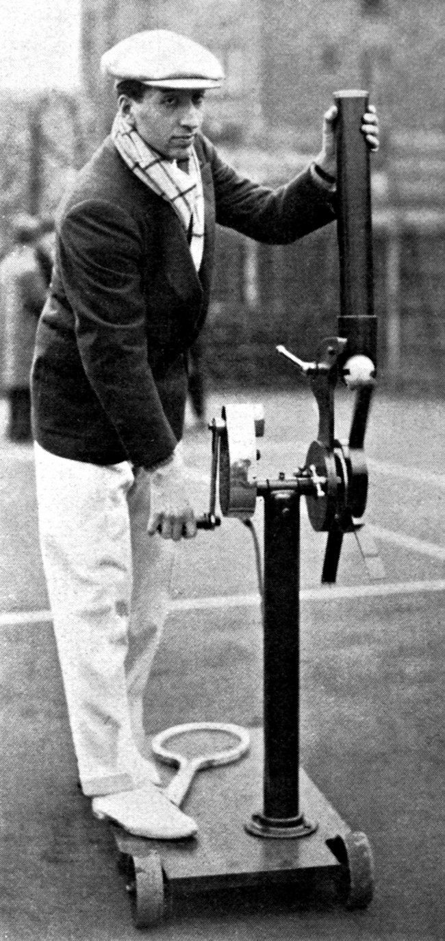 Henri Lacoste sets up his serving machine