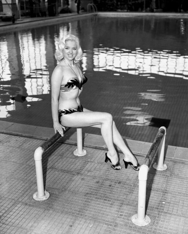 "Actress Diana Dors, in her early twenties, during the filming of ""Value For Money"" in 1955."