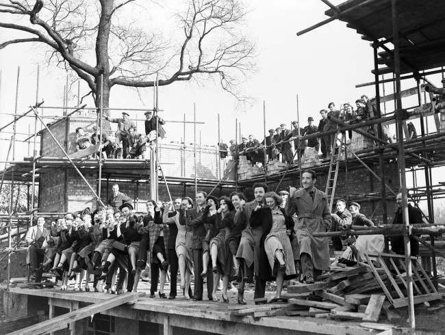 """The Festival of Britain - London - 1951 Actors from the BBC's radio show """"Down Lambeth Way"""" sing and dance on the site of the Festival."""