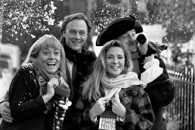 Stars in a festive mood today as they prepare to take part in the BBC Radio's line-up for the Christmas season. (L-R) Eastenders actress Wendy Richard makes her debut as a disc jockey standing in for Radio 2's Ken Bruce, Christopher Cazenove and Peter Jeffrey are lead players in classic adventure stories, and Jakki Brambles hosts Radio 1's Breakfast Show with Nikki Campbell (not pictured)