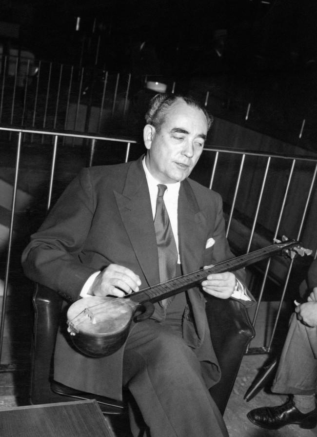 Tom Driberg, former Socialist Member of Parliament for Malden, Essex, with a r'bab, a Russian musical instrument, which he brought back to London Airport as a souvenir of his visit to Moscow, where he met runaway diplomat Guy Burgess. Ref #: PA.6656827   Date: 14/09/1956