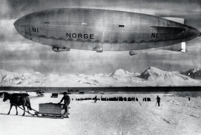 The airship Norge floats above Spitzbergen, Norway, in May 1926, before an expedition over the North Pole by Norwedian explorer Roald Amundsen. On May 11, 1926 Amundsen and his crew, including Italian Umberto Nobile who constructed and piloted ship departed in the Norge. Seventy-two hours later they landed at Teller, Alaska, becoming the first people to fly over the pole and confirming there was no land there.