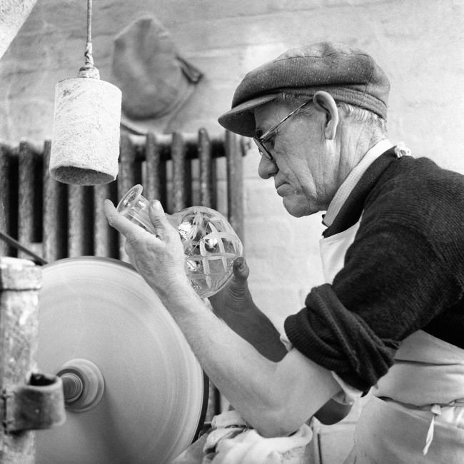 The skill of 48 years at the job goes into the work as Harry Jones hand-cuts a crystal decanter at a Stourbridge, Worcestershire, firm.
