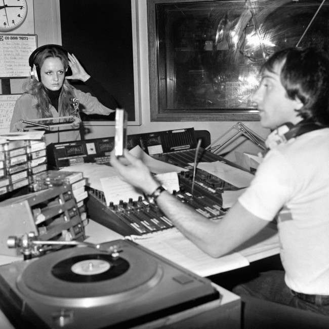 Model and singer Twiggy at the Capital Radio studios with Graham Dene, helping out on his show.
