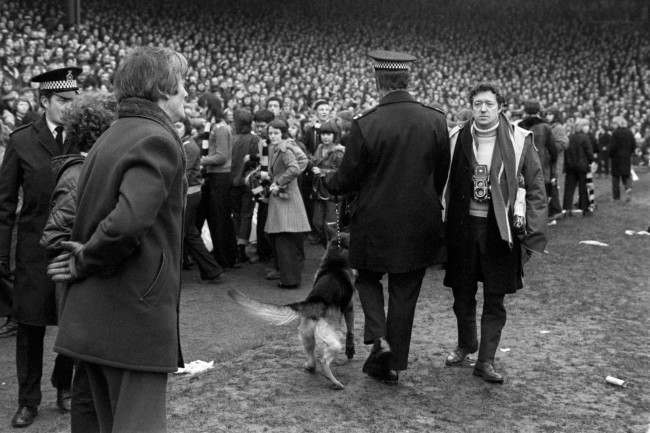 PA. 723459 Soccer - FA Cup - Sixth Round - Newcastle United v Nottingham Forest A policeman with an Alsatian herds the Newcastle United fans back onto the terraces after they invaded the pitch, hoping to get the match abandoned with their team 3-1 down and a man short Ref #: PA.723459  Date: 09/03/1974