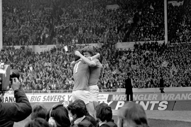 Manchester City's Peter Barnes (r) celebrates scoring the opening goal with teammate Dennis Tueart (l)