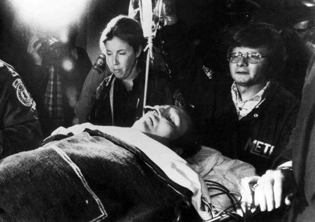 Ambulance attendants push a stretcher, carrying Hustler publisher Larry Flynt, through the door of Emory Hospital, Atlanta, on March 8, 1978. Flynt was the victim of a shooting 2 days earlier.