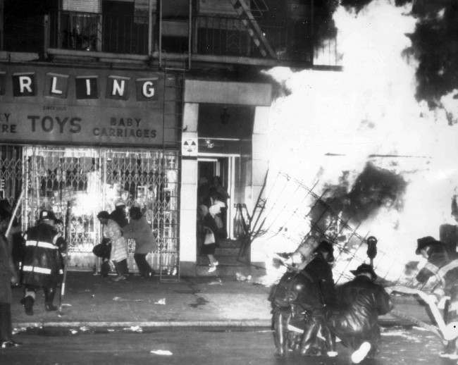Firemen battle a blaze on 125th Street in Harlem, New York, on April 4, 1968, after a furniture store and other buildings were set on fire after it was learned that civil rights leader Dr. Martin Luther King had been assassinated in Memphis.