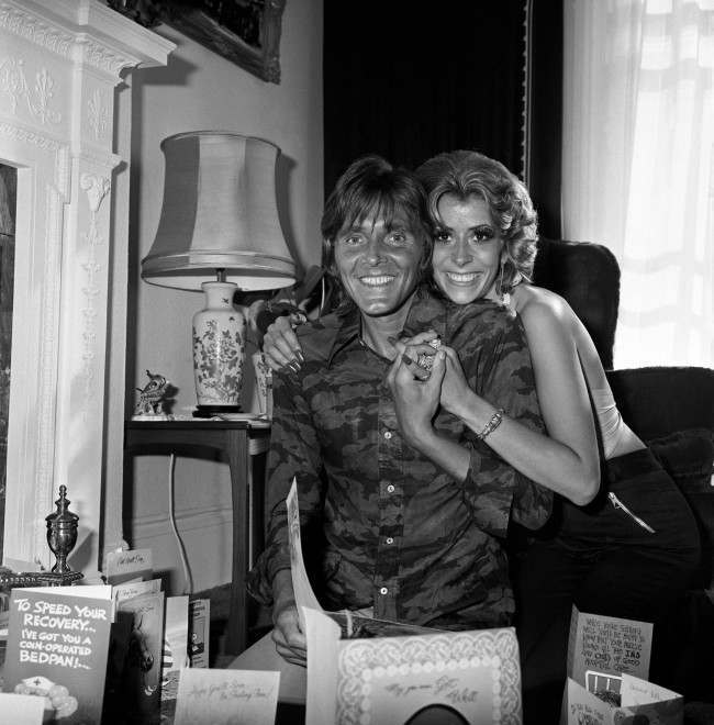 Pop singer Billy Fury (l) with girlfriend Lisa Rosen (r) at home recovering from heart surgery. 568889 Date: 12/07/1976
