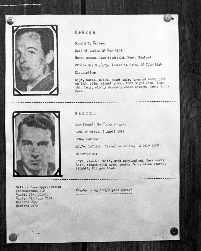 Portraits of the two missing British Diplomats, Donald Maclean and Guy Burgess, who mysteriosly disappeared complete with their descriptions are posted on the wall inside a United States Customs Post on the border of Germany and Czechoslovakia, on July 8, 1951.
