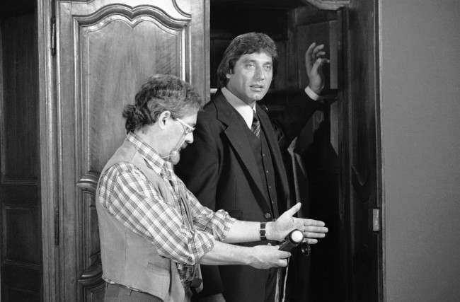 "Joe Namath stands by as a technician takes a reading during the filming of commercials for ""Joe Namath"" clothes in New York, March 30, 1977. Namath said nothing has been settled as far as his going to the Los Angeles Rams to play footbal"