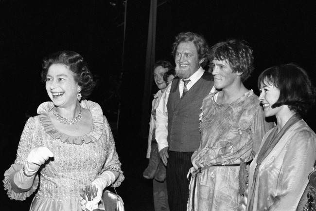 "Queen Elizabeth II laughing merrily whilst meeting the main character's after the Charity Gala performance of ""Peter Pan"" last night at the Barbican Theatre. From right: Jane Carr (Wendy), Miles Anderson (Peter Pan) and Joss Ackland (Mr Darling/Captain Hook). For the first time in the plays 78 year history, the title role created by J.M.Barrie was played by an actor, not an actress, in this Royal Shakespeare Company production."