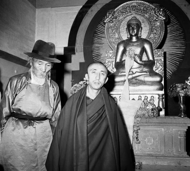 Silun Lukhwangwa, former Tibetan Premier (left) and Kushak Bakula, India?s leading Lama, leave Buddhist temple in New Delhi, India on March 31, 1959 after conducting prayers for Tibetans fighting Chinese communists in Tibet. Prime Minister Nehru of India spoke to refugees, led by Lukhwangwa in New Delhi and prophesied ?ultimate victory for Tibetans but urged them to be patient.