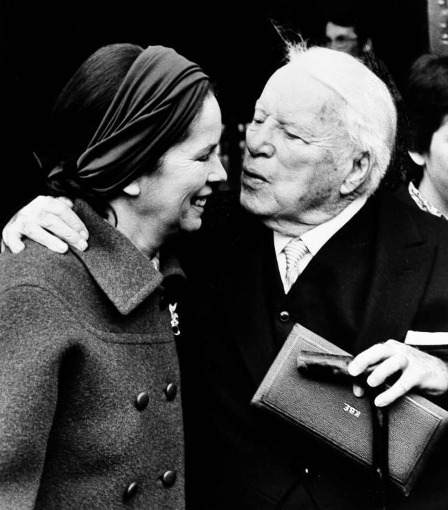 Actor Charlie Chaplin kisses his wife Oona outside of Buckingham Palace in London, March 4, 1975, after being knighted by Queen Elizabeth II in a private ceremony. In his hand is the box containing the insignia of Knight Commander of the Most Excellent Order of the British Empire.