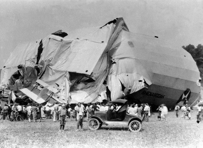 The airship USS Shenandoah lies in ruins in Caldwell, Ohio on Sept. 4, 1925. Fourteen crew members died and twenty-nine crew members survived the destruction of the airship which took off from Lakehurst, N.J., on Sept. 2. The Shenandoah was the first rigid dirigible made in America.