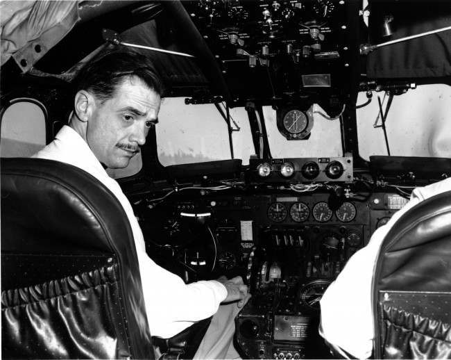 Aviation and movie magnate Howard Hughes demonstrates a new radar system, center below windshield, in the cockpit of an aircraft in Culver City, California on May 1, 1947.