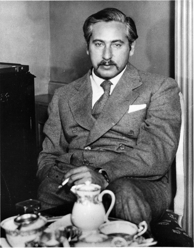 Austrian-American filmmaker and screenwriter Joseph von Sternberg is shown having tea in his London, England, hotel room on March 7, 1935.