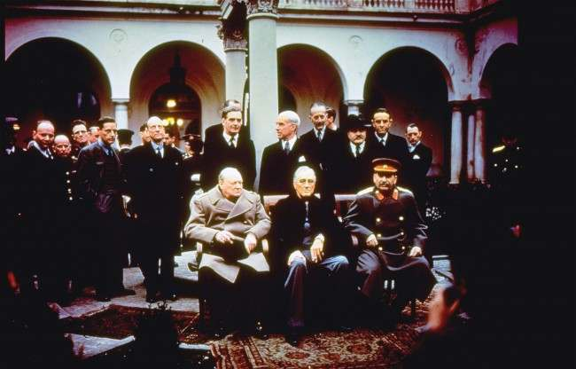 With their foreign secretaries behind them, British Prime Minister Winston Churchill, U.S. President Franklin Roosevelt and Soviet Premier Josef Stalin sit on the patio of Livadia Palace, Yalta, Crimea, Feb. 4, 1945. Standing, from left: Foreign Sec. Anthony Eden, Sec. of State Edward R. Stettinius, and Foreign Commissar Vyasheslav Molotov.