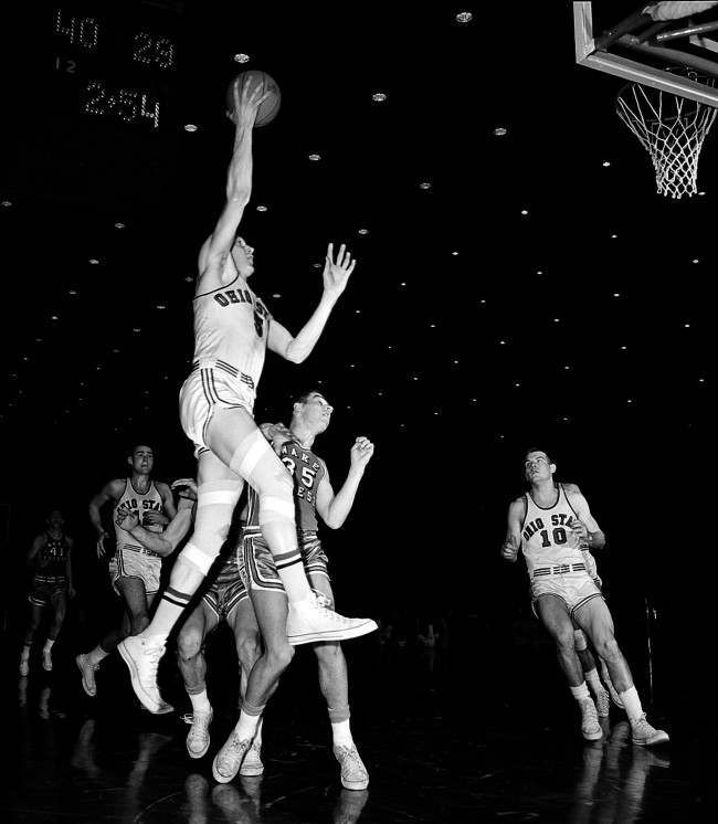 Ohio State's forward John Havlicek leaps into the air to toss a one-hander in the first round of the NCAA finals against Wake Forest, at Louisville, Ky., March 23, 1962.