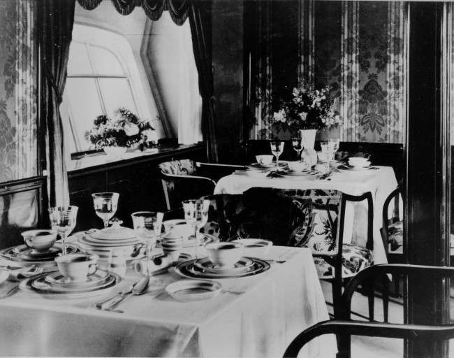 The Salon is transformed into a dining room aboard the German airship Graf Zeppelin circa 1928.