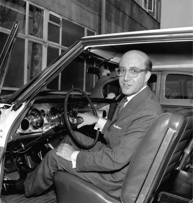 British actor Peter Sellers shows his new 1963 American Buick during a break in filming at Shepperton Studios in Middlesex, near London, England, March 3, 1963. Sellers is wearing a bald piece for his character in the movie