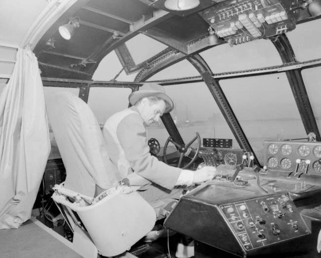 Howard Hughes sits at the controls of his giant wooden flying boat dubbed the Spruce Goose as he checked the aircraft prior to the first and only flight of the 25 million dollar plane, November 2, 1947, off Long Beach, California.