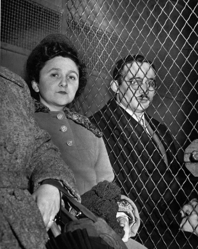 Ethel Rosenberg, 35, and her husband, Julius, 34, are separated by a wire screen as they ride to separate jails in New York City March 29, 1951 following their conviction as traitors in the nation's first atom spy trial. Convicted with them was Morton Sobell, a 33-year-old radar expert. They were accused of trying to deliver war secrets, including vital A-bomb data, to the Soviet Union.