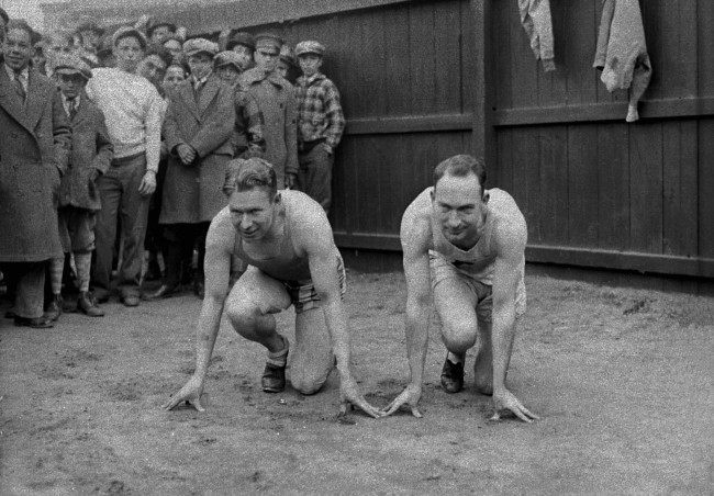 American sprinters and Olympic champions Jackson Scholz, left, and Charles