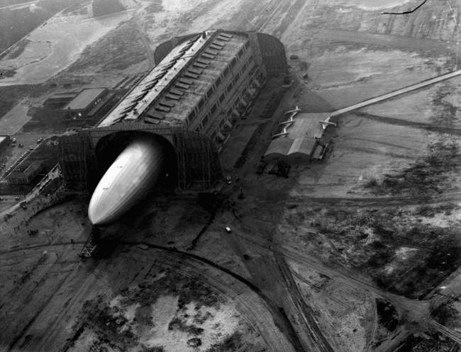 The German zeppelin Hindenburg, its nose hooked to a mooring mast, is guided into a U.S. Navy dirigible hangar in Lakehurst, NJ, May 9, 1936, after the first leg of 10 scheduled round trips between Germany and the U.S.