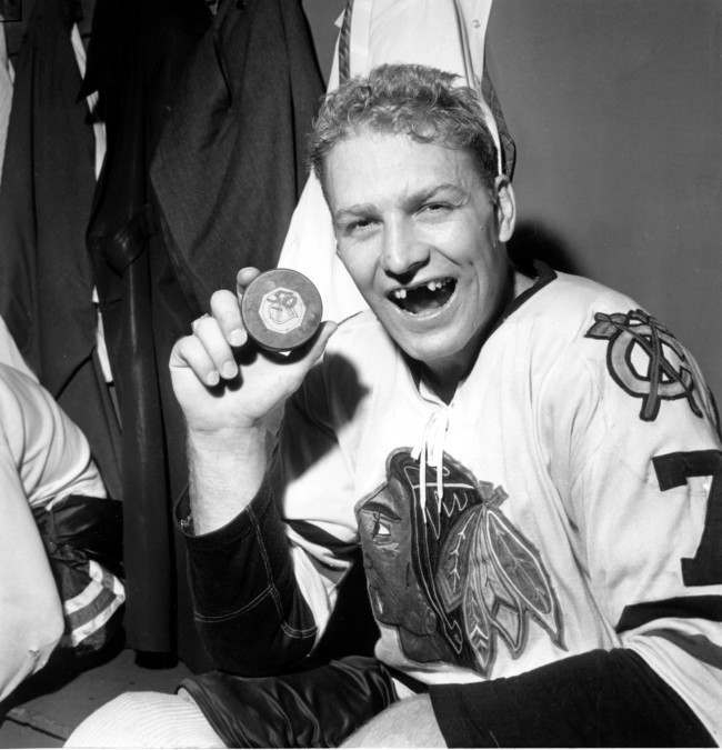 Bobby Hull of Chicago Blackhawks holds puck which he drove into New York Rangers' net to score his 50th goal of the season and to tie the National Hockey League record in the final game of this regular season. The 25-year-old scored less than five minutes into the game in New York's Madison Garden on March 25, 1962. Rangers won 4-1.