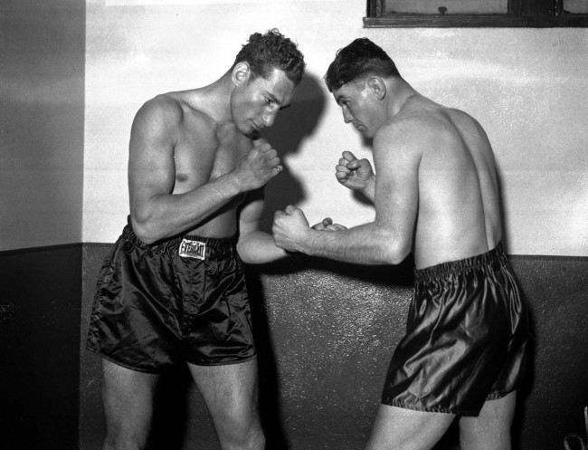 Art Lasky, left, and Jimmy Braddock, right, square off for cameramen March 22,1935 prior to their bout in Madison Square Garden. Lasky weighed in at 197 pounds and Braddock at 182 for the scheduled 15 rounder.