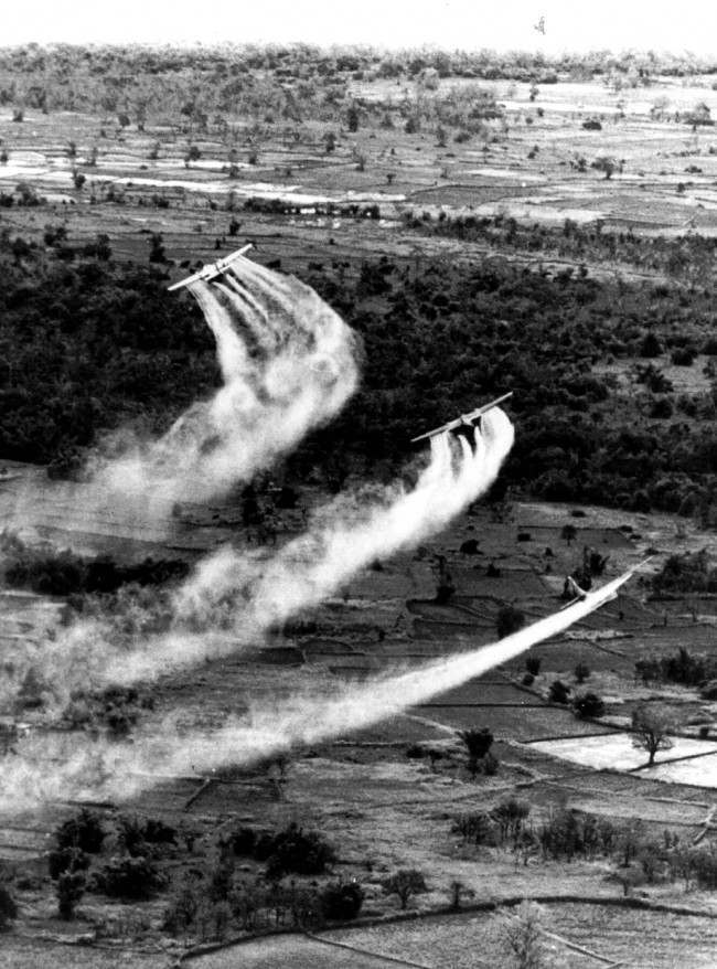 U.S. Air Force planes spray the defoliant chemical Agent Orange over dense vegetation in South Vietnam in this 1966 photo.