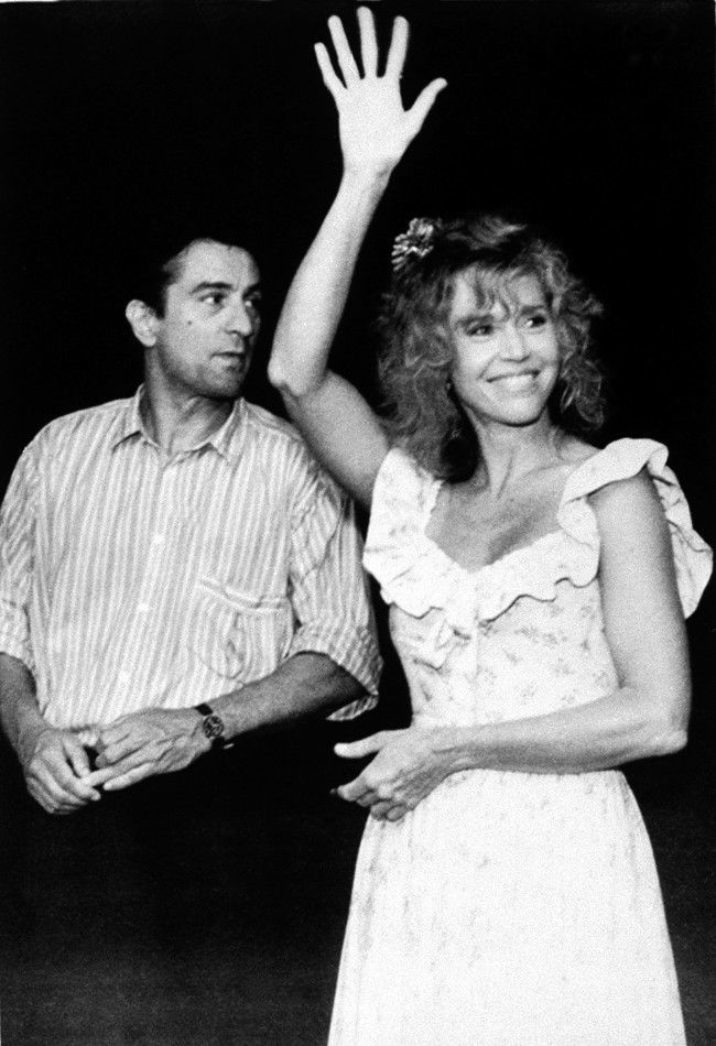 Actress Jane Fonda, waving to fans, and actor Robert De Niro arrive for the Brandie Schieb Children's Fund in Woodbury, Conn., Friday, July 29, 1988. The benefit is for children with birth defects due to Agent Orange, a toxic herbicide used by the U.S. military during the Vietnam War.