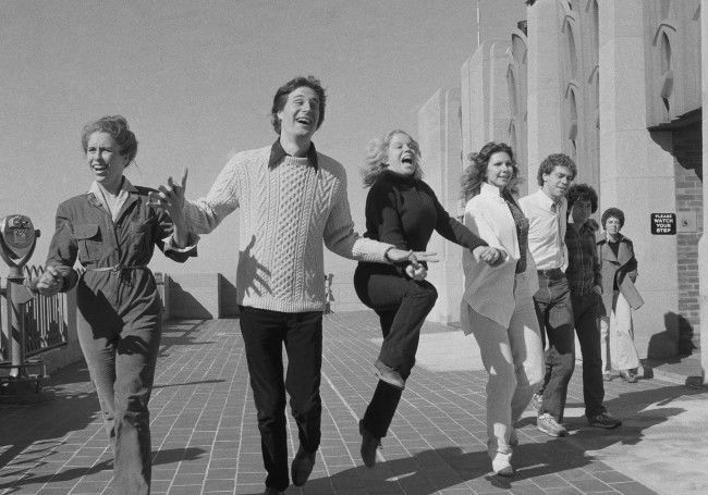 "New cast members of NBC-TV's remodeled ""Saturday Night Live"" frolic on the roof of the RCA Building at New York's Rockefeller Center, Oct. 23, 1980. The six cast members were chosen to succeed the program's ""Not Ready For Prime Time Players,"" most of whom have gone on to other acting endeavors. From left to right are: Gail Matthius, Charles Rocket, Denny Dillon, Ann Risley, Joe Piscopo, and Gilbert Gottfried."