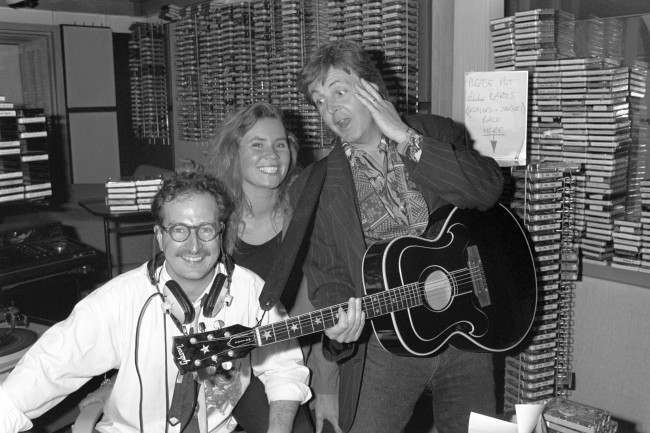 Paul McCartney surprising Radio 1 DJ Steve Wright and his production assistant Dianne Oxberry by dropping in for a chat after they broadcast an on-air appeal to meet him. Diane mentioned McCartney's name during a talk about the stars people would love to meet, and as he was working down the road on his new album, McCartney strolled into the studio and played live for Diane. Ref #: PA.8792508 Date: 13/06/1990