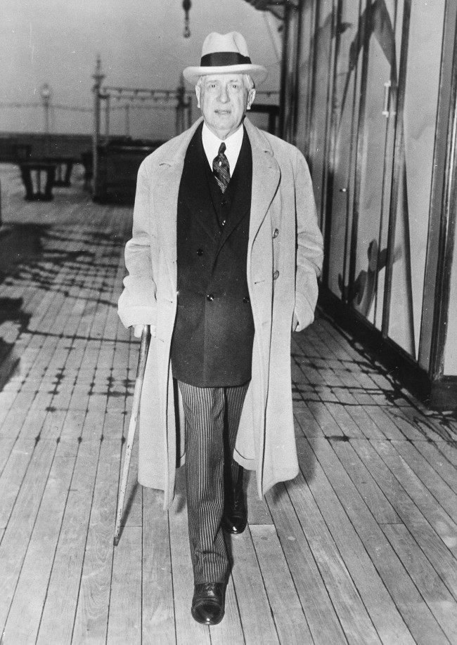 "Charles M. Schwab, chairman of the board of the Bethlehem Steel Corp., shown when he arrived in New York City on March 28, 1935, aboard the Rex. Usually optimistic, this time Schwab expressed pessimism to reporters about business in general. ""If the stock exchange figures have any bearing, it would seem that business is at a stand-still over the whole country"