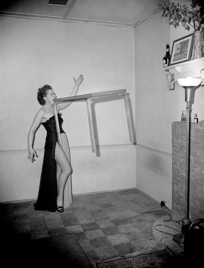 Britains Joan Rhodes lifts a table and swings it with her teeth