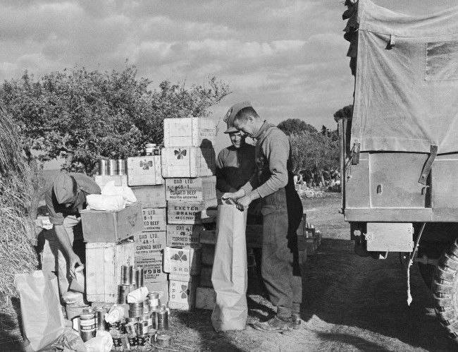 As far as the Royal Canadian Army Service Corps was concerned, the anti-malaria, synthetic quinine pill, Mepacrine, was just another item on the food list, to be rationed to units from supply points like bread and cheese and meat, Jan. 17, 1944. But as far as the Royal Canadian Army Medical Corps was concerned, Mepacrine in the Mediterranean was the difference between a strong healthy fighting forces an one which was ridden through with malaria. Men received their weekly ration of the little yellow tablets and the result among Canadians in North Africa, Sicily ad Italy was a less than 10\% malaria rate and only 0.25 deaths in every 1,000 men. Shown here is an R.C.A.S.C. supply point, with stocks of Mepacrine included among normal food items.