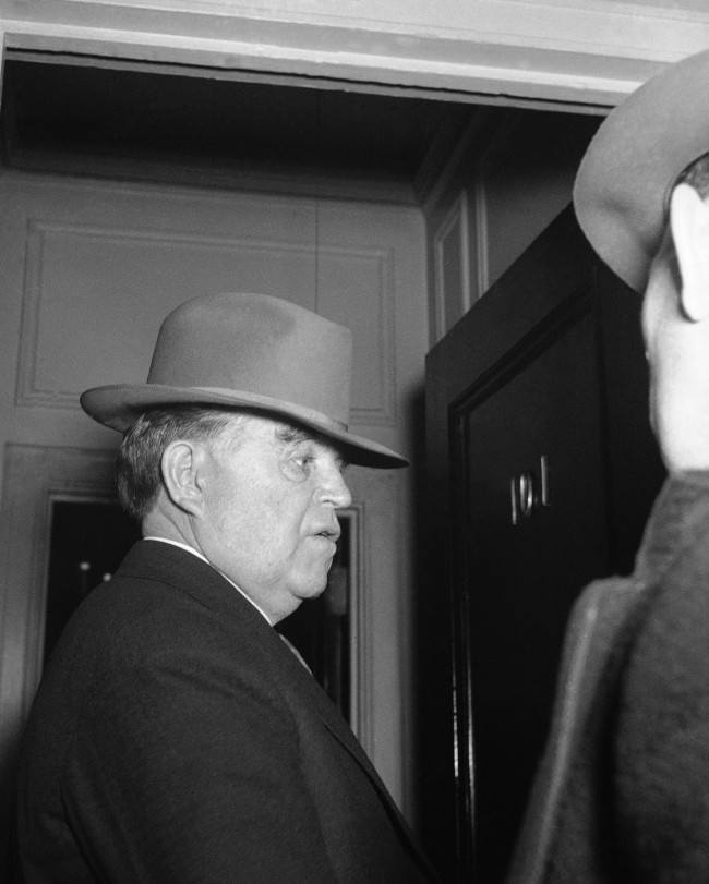 John L. Lewis, president of the United Mine Workers on his way to confer with soft coal operators, at NRA conference on wages and contracts for the soft coal industry in Washington, D.C., March 30, 1935.