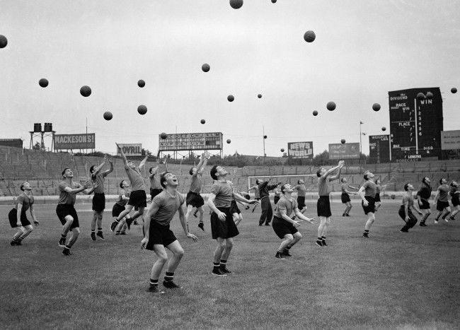 Players practice heading the ball Date: 29/07/1955