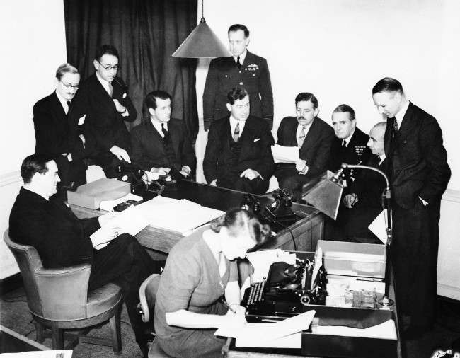A meeting of executives of Britain's Ministry of Information in London, Oct. 6, 1939 before the announcement that that much criticized body would be decentralized, returning most of its news dissemination tasks to individual government departments. (AP Photo) Date: 06/10/1939