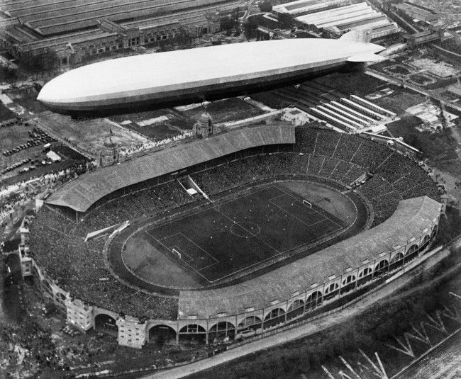 A Graf Zeppelin flying over Wembley Stadium in London, England on April 26, 1930, while the football cup final match between Huddersfield and Arsenal was in progress