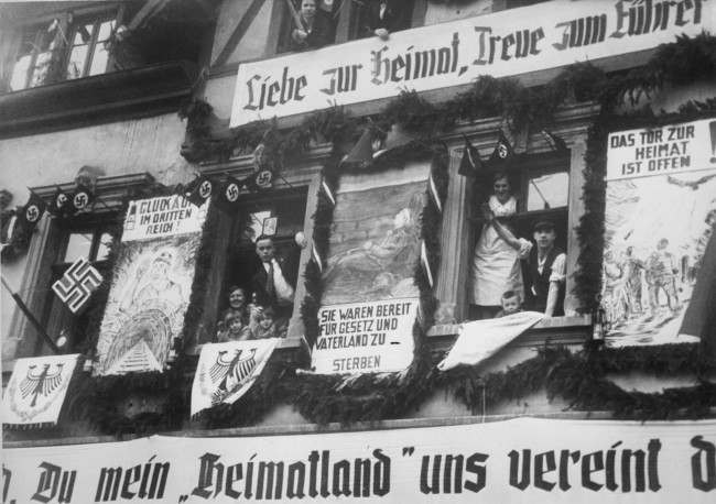 "Characteristic house inscriptions in Saarbrucken, March 2, 1935. ""Love for home, faith in the Fuehrer"". ""Much luck in third Reich"" ""They were prepared to die for Law and Fatherland"", ""The Home Gate is Open"", etc."