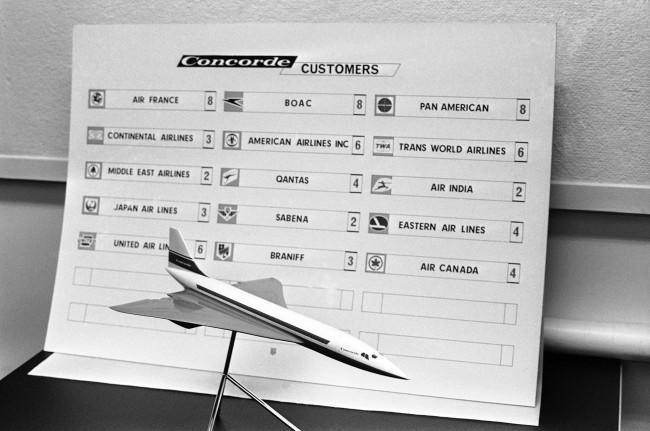 The International race is on to put the first supersonic transport on the market and eventually to dominate it. The British and French, jointly designing and building prototypes of their fixed-wing Concorde, are on schedule with Feb. 28, 1968, as the date for the jet's first flight. The American choice, a swing-wing Boeing, waits for a final go-ahead from President Johnson. But it will be bigger and faster. Its first flight is not expected before 1971. Here a Concorde model is seen in front of a British Aircraft Corporation sales chart, Jan. 18, 1967, showing 69 Concordes on order.