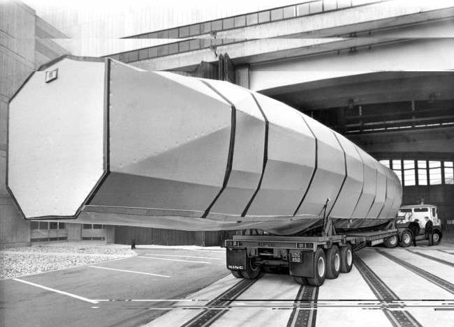 A section of the fuselage assembly of the Anglo-French Concorde airliner, weighing 5 tons and measuring 61 feet in length arriving at the Royal Aircraft establishment at Farnborough, Hampshire, England, April 23, 1967. The section still in its covering, is to undergo extensive stress tests in a special test Chamber at Farnborough.