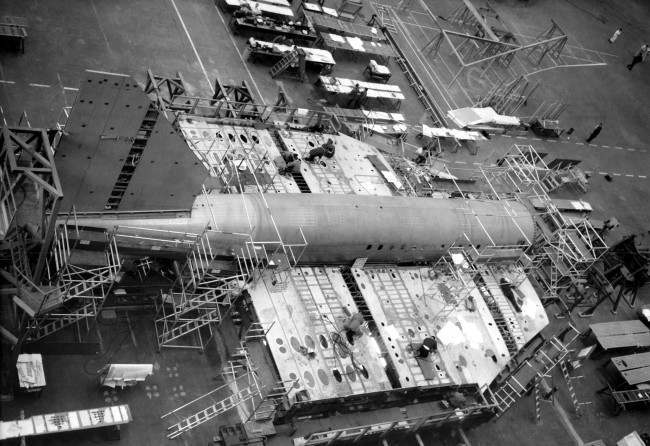 View of the Anglo-French Concorde supersonic jet airliner now under construction at the British aircraft corporation works at Filton, Bristol, England, Jan. 12, 1967, with the addition to the aircraft - the huge tail fin - in place. The aircraft building is running to schedule and it is hoped that the British-built Concorde will have its first flight in September 1968. The Concorde being built by the French at Toulouse, will, it is hoped, make its Maiden flight early 1968. So far the British aircraft corporation have received orders for 69 of these planes, the total cost of each being $16,800,000.